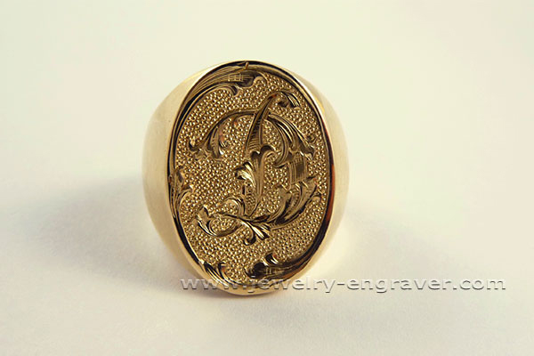 #308 - Hand engraved Monogram on a Signet ring.